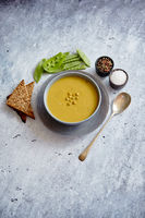 Green pea cream soup in grey bowl