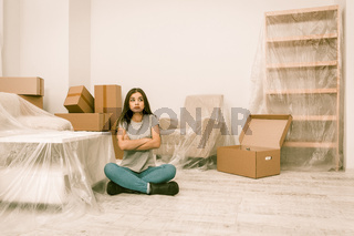 Female trying to be calm while moving in new flat