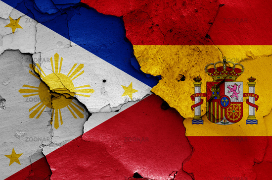 flags of Philippines and Spain painted on cracked wall
