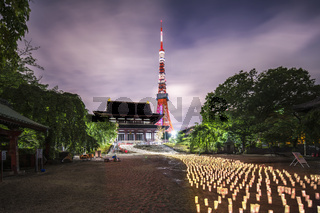 Japanese lanterns made of hand-made washi rice paper arranged in the shape of a milky way illuminating the stones of the steps of the Zojoji temple near the Tokyo tower during the night of Tanabata on July 7th.