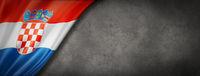 Croatian flag on concrete wall banner
