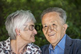 Pensioner looks at her husband