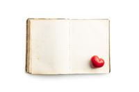 Love concept. Heart on open vintage book.