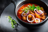 Traditional Hungarian goulash - stew of meat and vegetables with onions and herbs