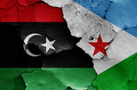 flags of Libya and Djibouti painted on cracked wall