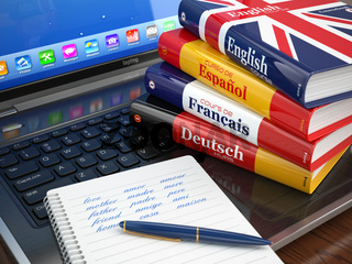 E-learning. Learning languages online. Dictionaries  on laptop.