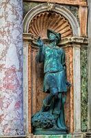 venice, italy - 03/15/2019 - statue of mercury at the loggetta at campanile di san marco