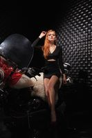Lovely red-haired woman posing in the studio