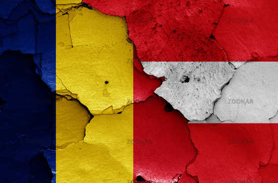 flags of Romania and Austria painted on cracked wall