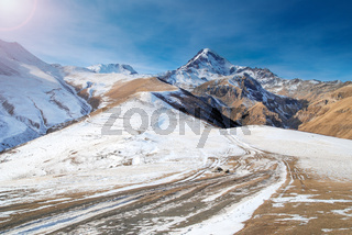 Winter mountains and a road
