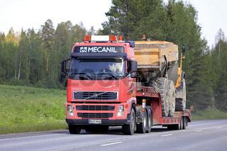 Red Volvo FH12 Truck Hauls Dumper