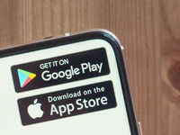 Google Play and App Store icons on infinity display smartphone