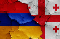 flags of Armenia and Georgia painted on cracked wall