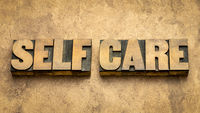 self care word abstract tin wood type