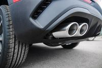 car exhaust pipe at shallow depth of field