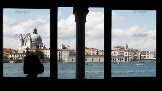 View through the Venetian Style Windows of Casa Tre Oci across Canale della Giudecca to Santa Maria della Salute During Corona During Corona Pandemia - Venice