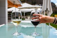 wine glasses on outdoor glass table