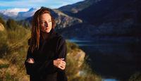 Woman posing on mountainous background