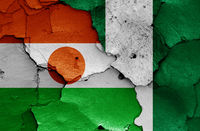 flags of Niger and Nigeria painted on cracked wall