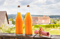 Two bottles of natural apple juice