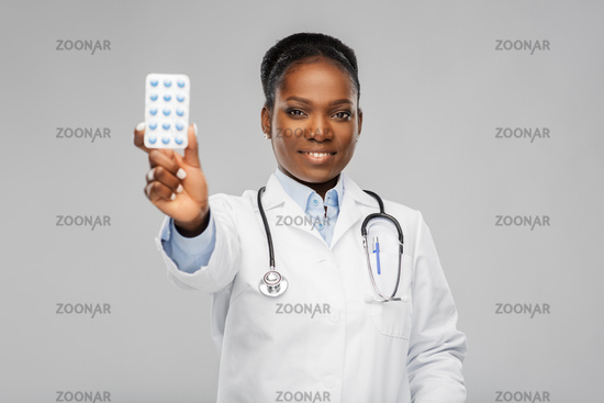 african american female doctor with medicine pills