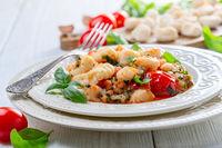 Traditional potato gnocchi with tomato sauce.