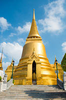 View of gold stupa near Temple of Emerald Buddha in Bangkok