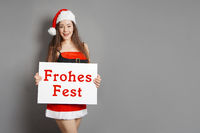 Frohes Fest - female santa wishes happy holidays in German