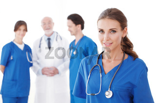Group of doctors on white
