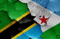 flags of Tanzania and Djibouti painted on cracked wall