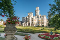Beautiful renaissance castle Hluboka in the Czech Republic is located in south bohemia. Summer weather with blue sky and rose gardens. UNESCO heritage.