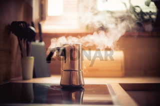 Making coffee in the morning: Italian coffee cooker vintage stove