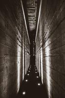 Dark tunnel in a bunker. Black and white photography