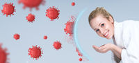 Concept photo of woman washing hands and face with soap in bathroom to clean skin from corona virus