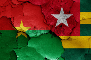 flags of Burkina Faso and Togo painted on cracked wall