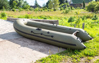 Rubber boat for fishing at the village in summer