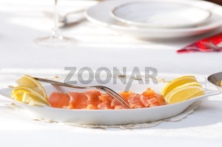 Raw salmon at the table with dressing