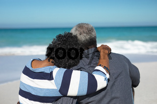 Old couple sitting on the sand