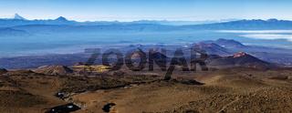 Stunning panorama volcano landscape of Kamchatka Peninsula: series of volcanic cones and lava plain