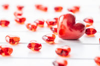 Red hearts on white table.