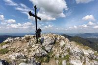 Summit cross on the Fockenstein peak in Bavaria, Germany, in springtime