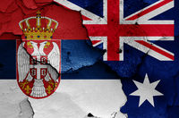 flags of Serbia and Australia painted on cracked wall