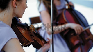 Musical Orchestra Of Female Musicians Plays Outside