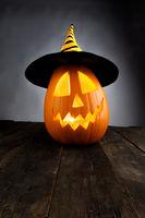 Jack-o-lantern on wooden background