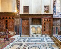 Wooden painted floral patterns, arched niche, wooden door, decorated cupboard, and marble floor
