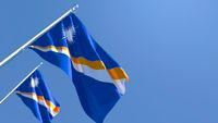 3D rendering of the national flag of Marshall Islands waving in the wind