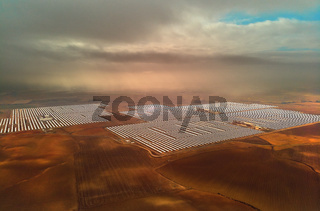Aerial image drone point of view photo Gemasolar Concentrated solar power plant CSP, system generate solar power using mirrors lenses to concentrate large area of sunlight onto receiver, Seville Spain
