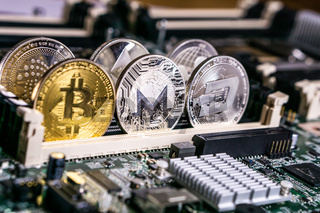 Bitcoin and altcoin Cryptocurrency on computer circuit board