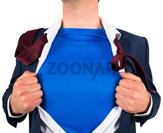 Businessman opening his shirt superhero style