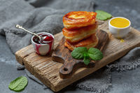 Puffy yeast pancakes with berry sauce.